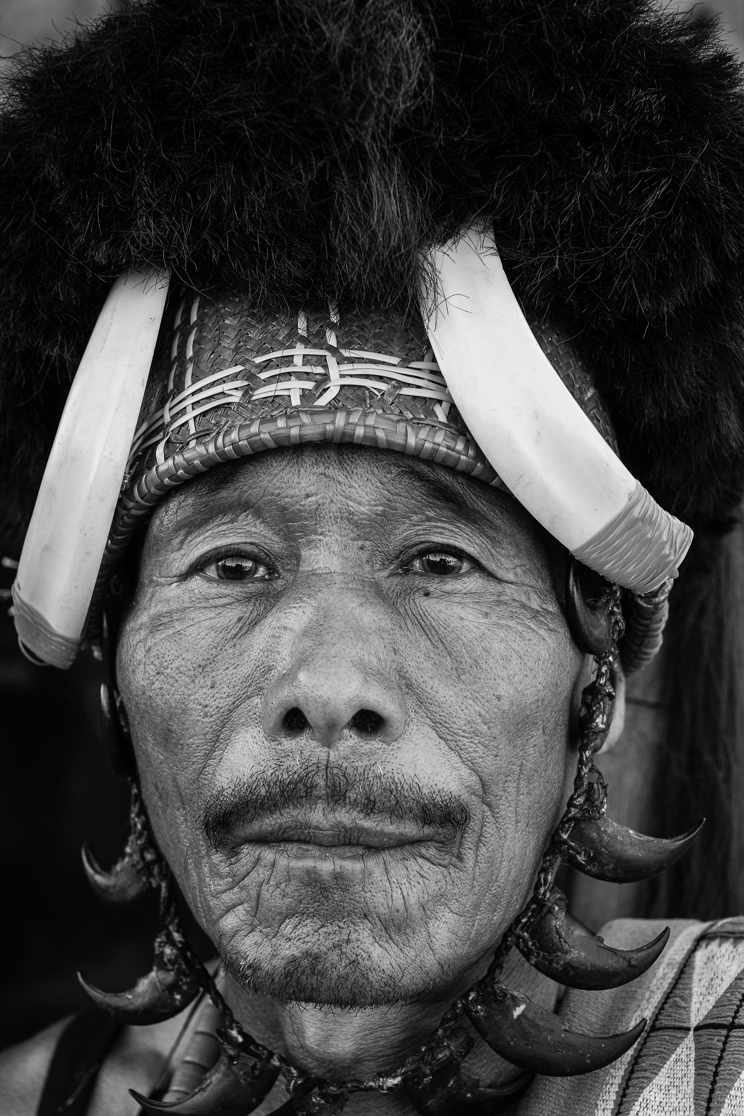 Portrait of a Naga Elder in traditional headgear